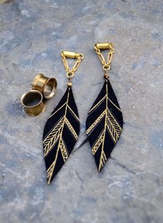 "Intrepid Jewelry - ""MAYA"" Gold and Black Small Aztec Leather Feather Earrings by BellaDrops, $34.99 (http://www.intrepidjewelry.com/maya-gold-and-black-small-aztec-leather-feather-earrings-by-belladrops/)"