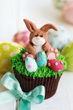 Easter bunny cupcake with colorful Easter eggs - by Ruth Black