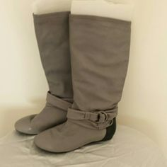 Leather boots by B makowsky A really cute boot by B makowsky they are all leather different tone on the heel, nice flat heel comfortable to wear wore a few times  excellent condition Shoes Winter & Rain Boots