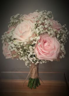 A bouquet with Sweet Avalanche roses and gypsophila.