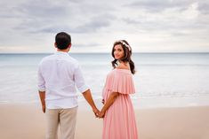 Breathtaking sunset beach maternity babymoon photography session on the Big Island of Hawaii. Have a Babymoon photo session to capture pregnancy in Hawaii. Hapuna Beach Maternity photo session for babymoon couples in Waikoloa, Hawaii near Kona.