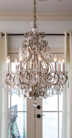 beautiful Louis XVI crystal chandelier with beaded arms in the room; crystal chandeliers