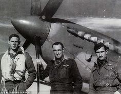 As he celebrates his 100th birthday, Mr Nicholls, pictured (centre) with two…