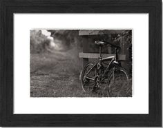 BLACK AND WHITE PRINT IN METROPOLITAN 143FINE ART FLOAT CHARCOAL FRAME    Original black and white photograph by Kim Worthington, founderof WorthingtonPhotoArt.    Why    I took this image whilst walking along a towpath alongside a canal. The bike was not mine. I came across it. There was nobody around. I imagined that the person who owned it,had taken a picnic into a nearby field and was lying in their backs watching the clouds drift. Hence the title.    In a nutshell    Taking fine art…
