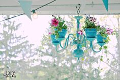 Chandelier Planter Tutorial. I'd love a bright red one next to the front door.