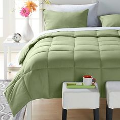 Many different colors with this one, they aren't the down feathers but they might do the job  Concierge Collection Embossed Bouclé Down Alternative Comforter at HSN.com.