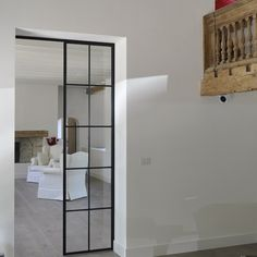 Steel door, white interior and pale wood - gorgeous!
