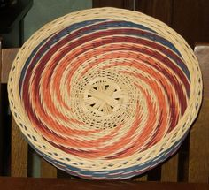 Round Spiral Weave Tray, in natural, peach, rust brown & some dark blue I have a lot of...