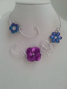 Here is a jewelry to wear in any occasions :  prom, wedding, bridal, ceremonies, anniversary.  It's an unique necklace made with aluminium wire, metallic flower, acrylic flowers.  If you need earings