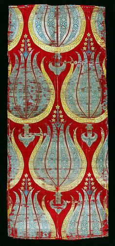 wallacegardens:    Turkish woven textile, tulips, late 16th Century, silk and silver lamella. The tulips represent true-to-life depictions of Turkish plants, but with the added abstract emblem-like elements.