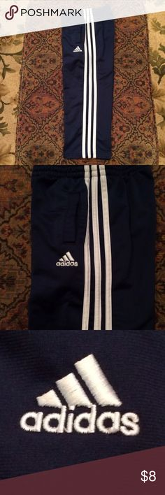 Boys Adidas Pants Boys Adidas athletic pants in navy with a white accent stripe down each side. Functional pockets on each side on the front. In like new condition except for the tag. Cheaper on Merc. Nike Bottoms Sweatpants & Joggers
