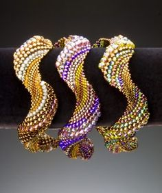 By Gina Dunlap Waveform Trio I Bracelet. Peyote stitch beadweaving, various colors. As seen in Bead and Button magazine, October 2009