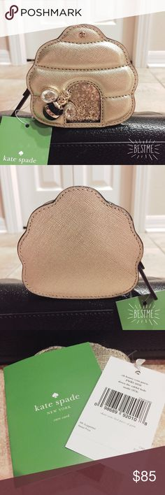 🆕 kate spade beehive coin purse with glitter 🐝 🆕 kate spade beehive coin purse with glitter 🐝 never used and has been kept in plastic packaging minus photographs. Brand new with tags attached and care card. Collector's item! Price firm! Will consider lower offers but no lowballs! No trades or PayPal! ❌ kate spade Bags