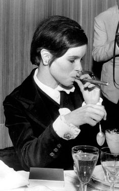 American actress Geraldine Chaplin smokes a cigar at the Cannes Film Festival May 1967 Smoking Ladies, Girl Smoking, Charlie Chaplin, Geraldine Chaplin, Cigar Girl, Good Cigars, Star Wars, Cigar Smoking, Actors