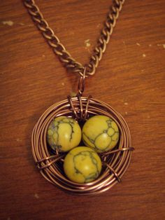 HANDMADE Copper Bird's Nest Necklace with Crackled Yellow Eggs ($15)