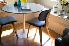 25 First-Rate - Amazing Home Interior And Decor Ideas : Indescribable round white dining table beside two chairs on brown hardwood flooring Office Furniture, Furniture Design, Furniture Market, Quality Furniture, Table Furniture, White Dining Table, Dining Chair, Dining Area, Dining Rooms