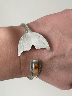 This is to pre-order these Sterling cuff bracelet. PLEASE GIVE ME 2 WEEKS PROCESSING TIME.  This nautical beauty was made from a Towle Silver sterling spoon. The pattern is called Candlelight and is from 1934.   Please keep in mind these are sample photos, the pattern is the same but each tail come out slightly different being all hand made.  For size these are bangle/cuffs, meaning they can be warn loose or be tighten a bit by slightly squeezing with your hand. These bracelet are about a…