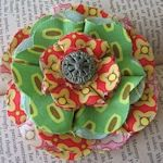 I'm thinking of sewing some new purses by using old blue jeans and new fabric, and embellishing with fabric flowers for a little bling.  This sight has links to several tutorials on how to make 40 different fabric flowers.