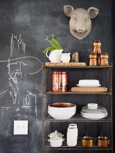 Galvanized metal shelves keep frequently used dishware at the ready.
