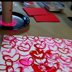 Did this a couple weeks ago with my 3 year old nephew. Took an empty toilet paper roll and carefully folded it. Then put some pink and red pair on a paper plate. Let my nephew dip the toilet paper roll in the paint then stamp it on the paper. We let it dry then folded the paper for valentine's cards for his mommy and daddy!