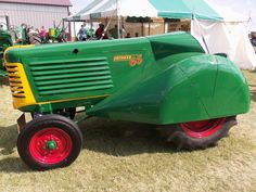 Undoubtably a restored Oliver 66 orchard tractor