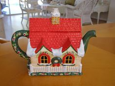 Christmas Cottage Teapot ... in shape of country cottage or house decorated for Christmas, with snow on bright red roof, chimney as knob