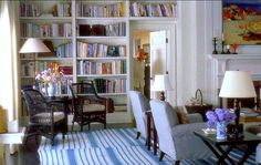Something's Gotta Give came long before Revenge but it definitely confirmed the timeless elegance of Hamptons style. Here built-in bookshelves frame the door and provide a reading nook. That striped rug   is a classic element of the style
