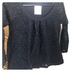 Lace top Sleeves are complete lace the main top is lace but is double layered with a top underneath the lace. Dark navy blue. Hollister Tops