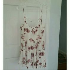 Brandy pink floral jada dress Open back, never worn BNWOT Pair with this cute maroon sweater that I also have for sale in my closet! Brandy Melville Dresses Mini