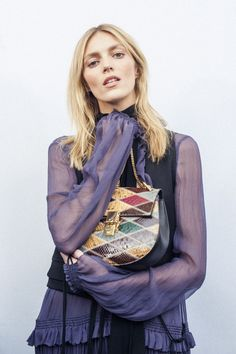 Anja Rubik backstage at the Chloé Fall-Winter 2015 runway with the Drew bag in colourful patchwork