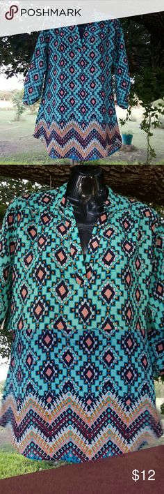 Multicolor Long Blouse Tunic Size S 3/4 Sleeves This is a beautiful multicolor long blouse or tunic. It has 3/4 Sleeves and two different patterns. Most of the blouse in the upper part has diamond shape figures and in the bottom has like  Zigzags that go from one side to the other. Rue 21 Tops Blouses