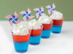 These firecracker jell-o shots are sure to spark up your Fourth of July party. They are sweetened with Blue Curacao and grenadine, spiked with vodka and topped with whipped cream.