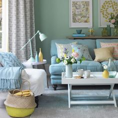 This room features several shades across the broad duck egg colour spectrum, and the natural blend of blues and greens makes for a fresh, foolproof colour palette. Perfect for clutter-lovers, duck egg's calming effect will offset busyness if you like to h Duck Egg Blue Living Room, Blue And Green Living Room, Pastel Living Room, Teal Living Rooms, Living Room Color Schemes, Shabby Chic Living Room, Rugs In Living Room, Living Room Designs, Living Room Decor