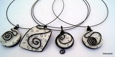 love the loose curled black wire on top of simple white with fine delicate designs  Disenyarte