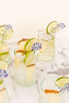 A tropical cocktail recipe for pineapple lime sangria spritzers. Love the edible flower garnish.