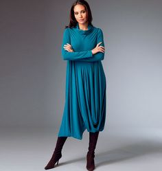 B5986 Very loose-fitting, pullover dress has right and left extending into collar and drape (tacked at hemline), no side seams, and partially elasticized hemline. Right and left sides are cut on crosswise grain. #butterick