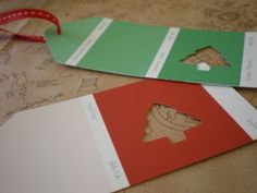 Gift Tags made out of paint chips - http://www.aspoonfulofsugardesigns.com/2008/10/quick-christmas-gift-tags.html