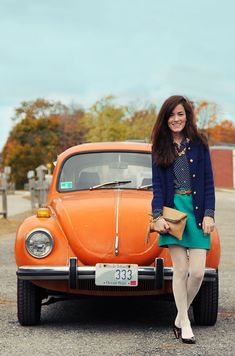 Classy Girls Wear Pearls: Tangerine Punch Buggy {I love the military style of this cardigan and how she styles it with a button down and skirt}