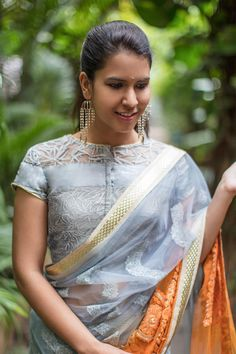 latest net blouse designs for sarees Looking for latest blouse designs for net sarees? Here are 46 ultimate net blouse collections that you can rock with any saree! Netted Blouse Designs, Saree Blouse Neck Designs, Dress Designs, Saris, Net Saree Blouse, Saree Blouse Models, Saree Jackets, House Of Blouse, Net Blouses