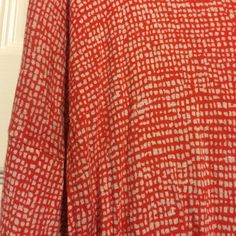 Long-sleeved lightweight shirt from Gap. Long-sleeved coral striped, lightweight sheet top from Gap. No evident wear. Great for the summer with a fun necklace! Size M. GAP Tops Blouses