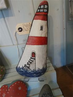lighthouse : painted pebble                                                                                                                                                     More