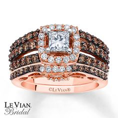 Three rows of simply scrumptious round Chocolate Diamonds® pour from each side of the princess-cut Vanilla Diamond center of her engagement ring as part of this set from the Chocolate Weddings™ Collection by Le Vian® Bridal™. The center is offset with a frame of additional round Vanilla Diamonds®. Round Chocolate Diamonds® and Vanilla Diamonds® make a dazzling appearance on the matching wedding band, contoured to fit around the engagement ring. Vanilla Diamonds® sparkle among an Ocean Wave™…