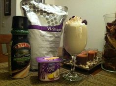 FRIDAY NIGHT BAILEY'S SHAKE:  1 Pineapple Coconut Light & Fit.  2 Scoops Vi-Shake Mix  8 oz. Pure Almond Milk (Unsweetened)  2 oz. Baileys Coffee Creamer  A small amount of Almond Extract  Blend all ingredients, serve in a wine glass, garnish glass with No Fat Whipped Cream, Blueberries, Raspberries and a hint of Ground Cinnamon!