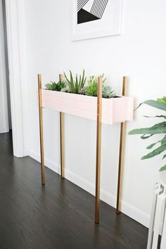 Lovely Add some green space to your foyer with this DIY skinny planter stand. The post Add some green space to your foyer with this DIY skinny planter stand…. appeared first on Home Decor . Diy Home Decor, Room Decor, Diy Plant Stand, Plant Stands, Plant Box, Modern Plant Stand, Ideias Diy, Minimalist Home Decor, Modern Minimalist