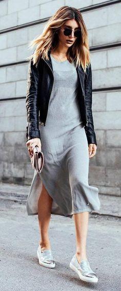 Black moto jacket & gray dress.