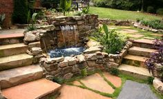outdoor living space with water feature
