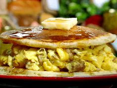 Sausage Pancake Egg Sandwich from FoodNetwork.com But do not use pancakes batter for this use boxed pancakes it is so much better