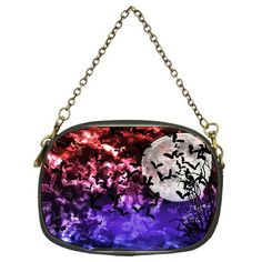 """Bokeh light bats in red and purple moonlight. Bokeh Bats in Moonlight Chain Purse (One Side). The evening purse illustrates elegance in a small package. This party accessory features a 16"""" vintage brass-colored chain, giving it a unique feel that is unrivaled. Design images are heat transferred using a heat dye sublimation technique, ensuring no discoloring, even if it makes contact with water.Made from leather.Nylon interior features a zippered hidden compartment.Zippered top…"""