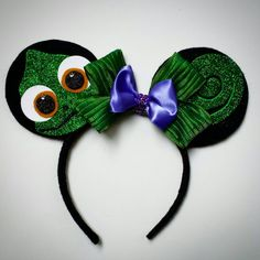 Check out this item in my Etsy shop https://www.etsy.com/listing/226412605/tangled-pascal-inspired-mouse-ears
