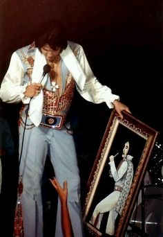 Elvis accepting a painting from a fan ~ June 1976 (possibly in Atlanta ???)